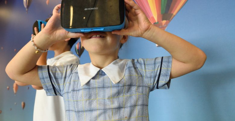 kid with virtual reality googles